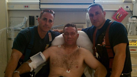 Burn survivor Mike Feyh with fellow firefighters
